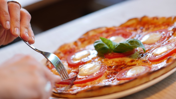 What Does the Size of a Pizza Slice TeachUs?